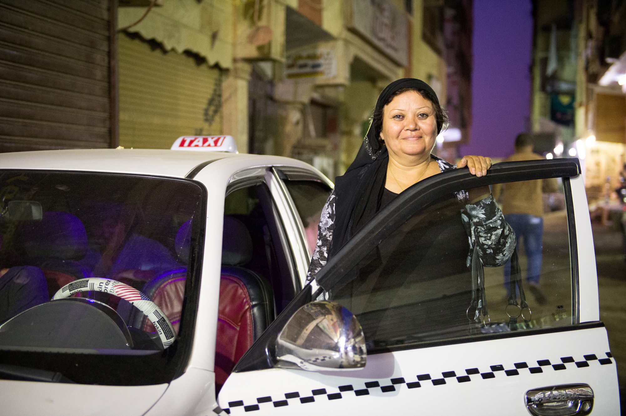 Portrait of Nour, female taxi driver, Cairo, Egypt