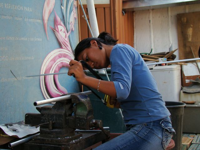 Woman at Palabra's antenna building workshop in Oaxaca, Mexico
