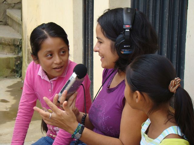 Mala Muñoz recording a radio program with young girls in Oaxaca.