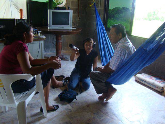 Two young female broadcasters conducting an interview in Oaxaca