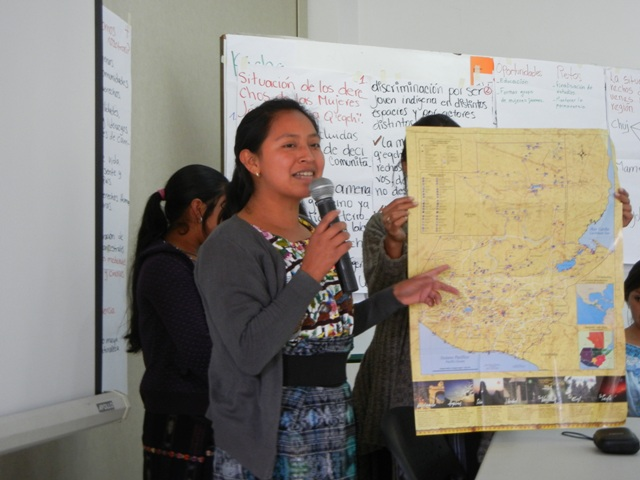 Indigenous woman explaining map